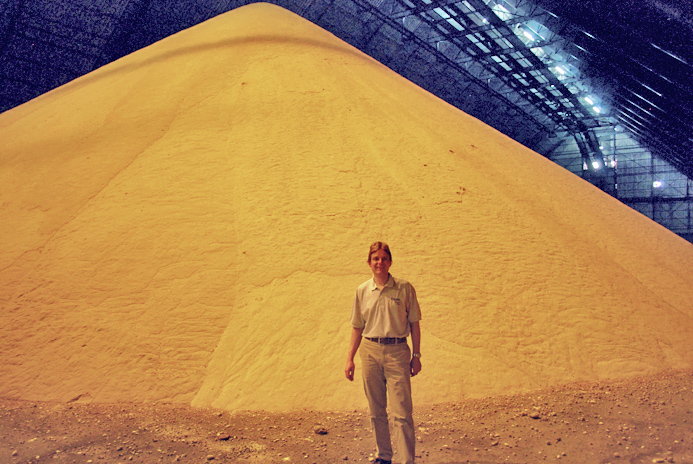 Ben Eastick in front of 15,000 tonnes Guadeloupe raw sugar
