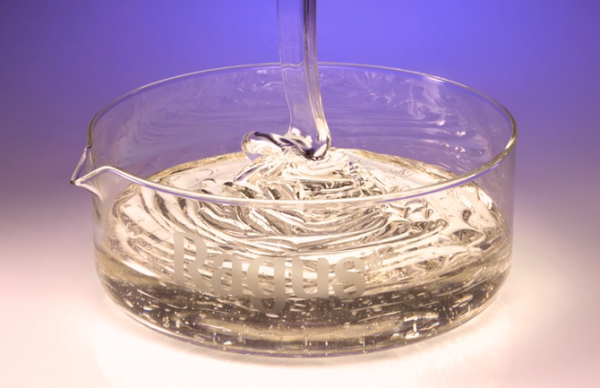 Image of glucose syrup pouring into dish with transparent colour