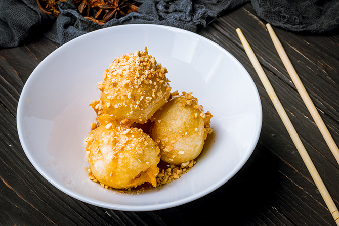 Deep fried bananas, banana fritters sesame seeds golden syrup chinese new year