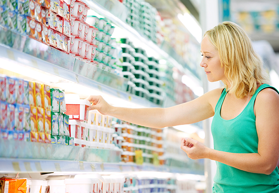 woman choosing produces in dairy shopping mall