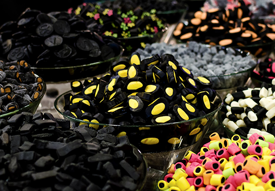Many varieties of liquorice sweets candies on a market stall.