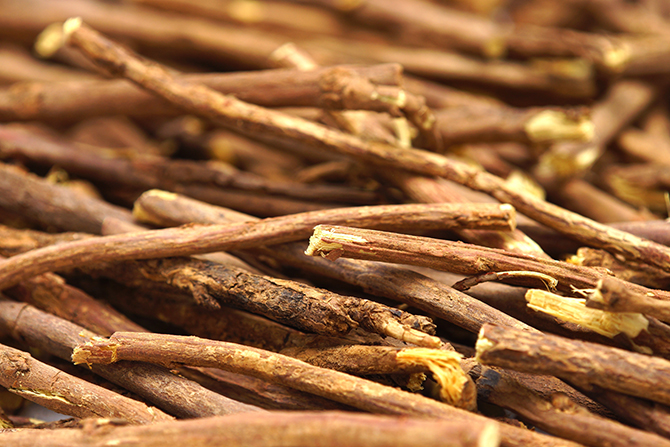 Licorice root on white background