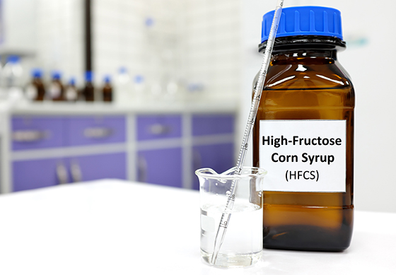 High-fructose corn syrup or hfcs food and beverage sweetener in dark brown glass bottle inside a laboratory.