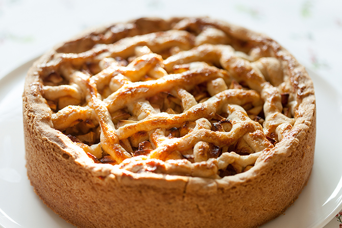 Close-up of Dutch apple pie appeltaart on a white plate