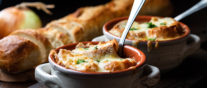 French onion soup in soup crocks with toast and cheese topping