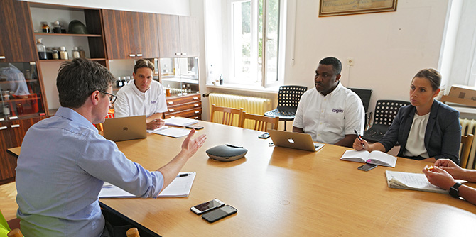 Ragus directors in a meeting with food and beverage partners while sitting around a table