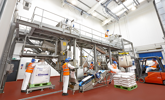 Image of Ragus production facility with demerara sugar being bagged.