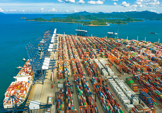 Birds eye view of Yantian port, showing thousands of shipping containers and bulk freight transportation methods